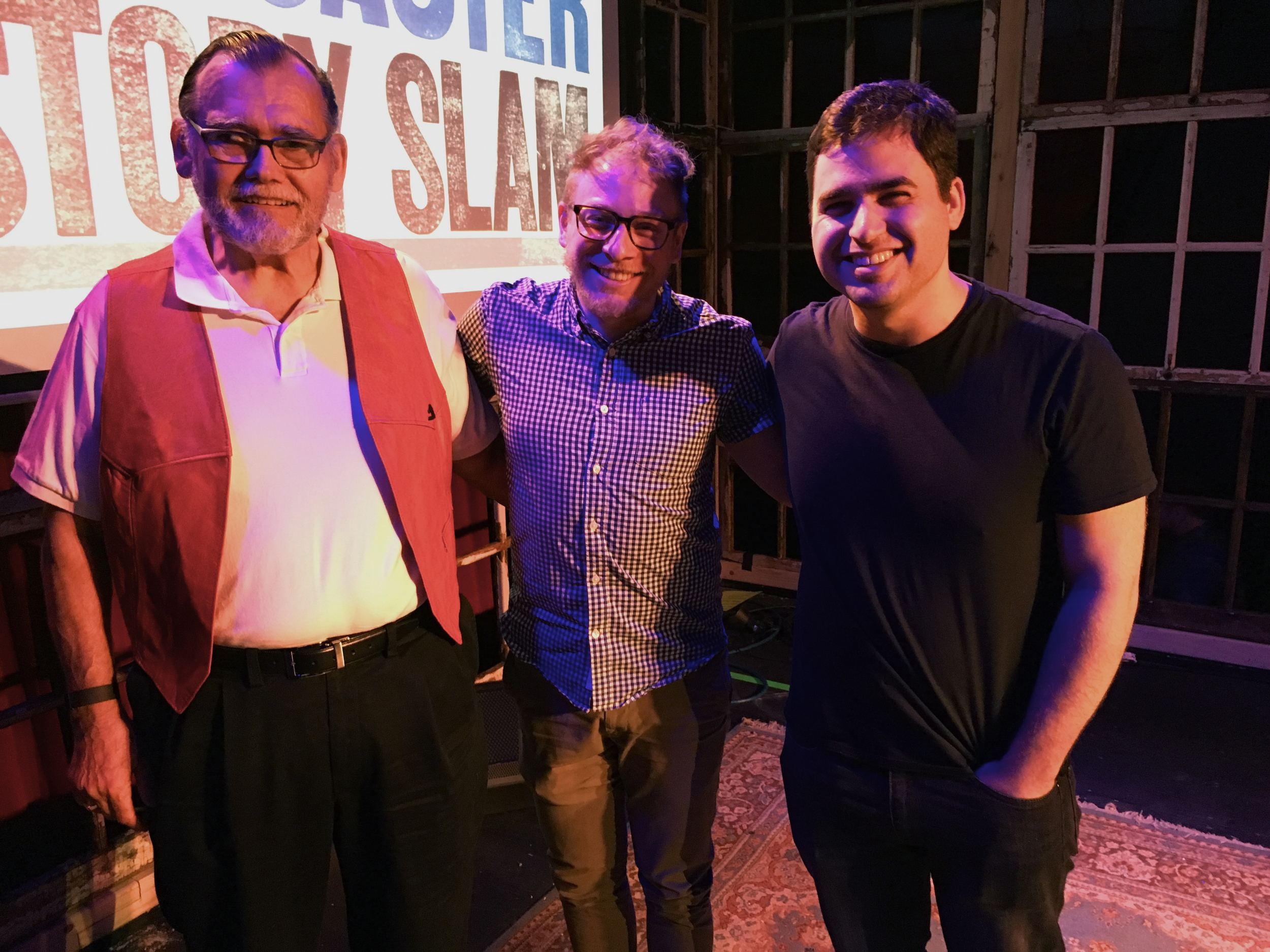 Winner Aaron Spangler (center) poses with John Strogus (left), and David Lasky (right)