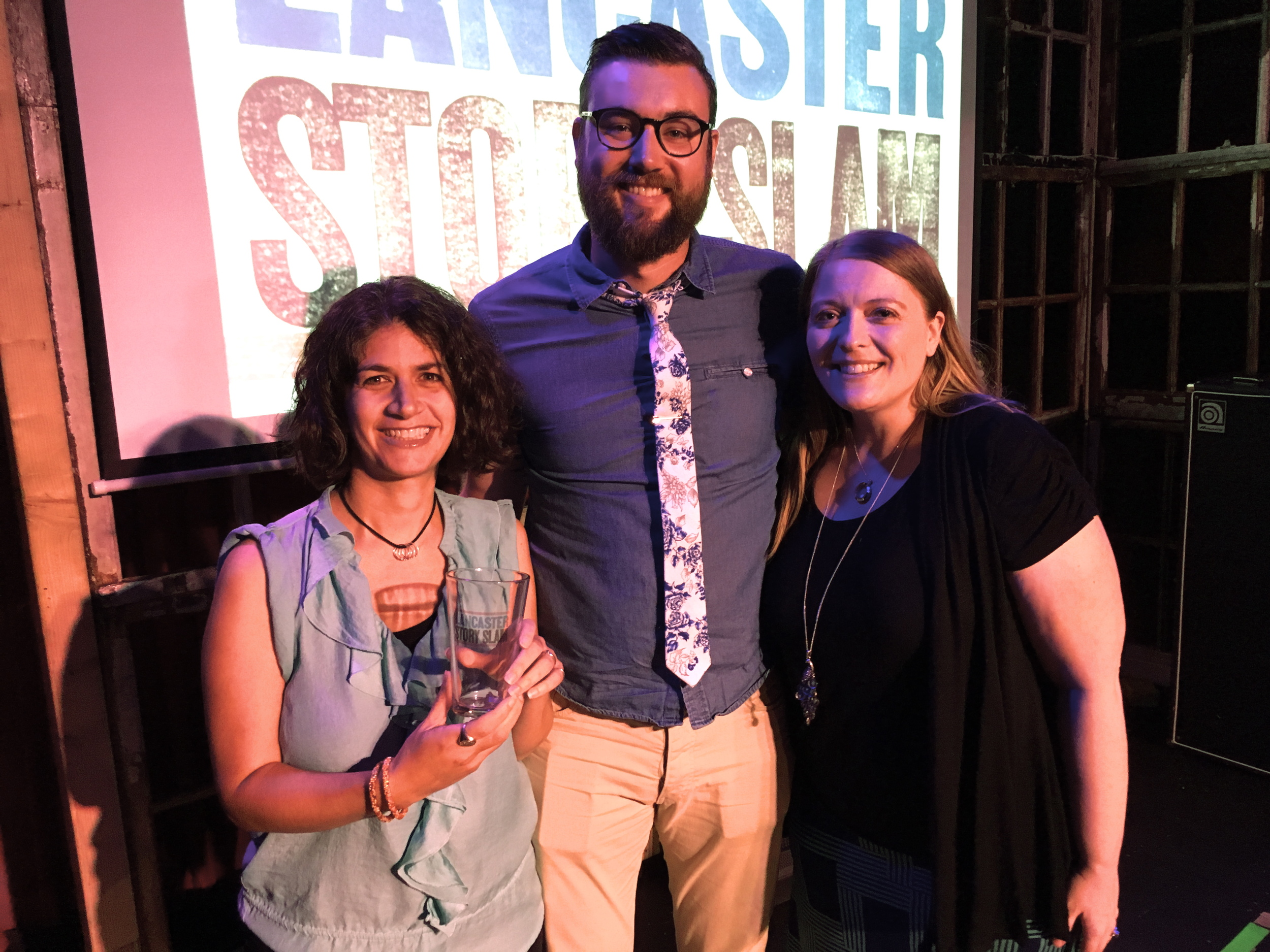 Jamie Beth and Bryan Caine pose with emcee Donna Talarico