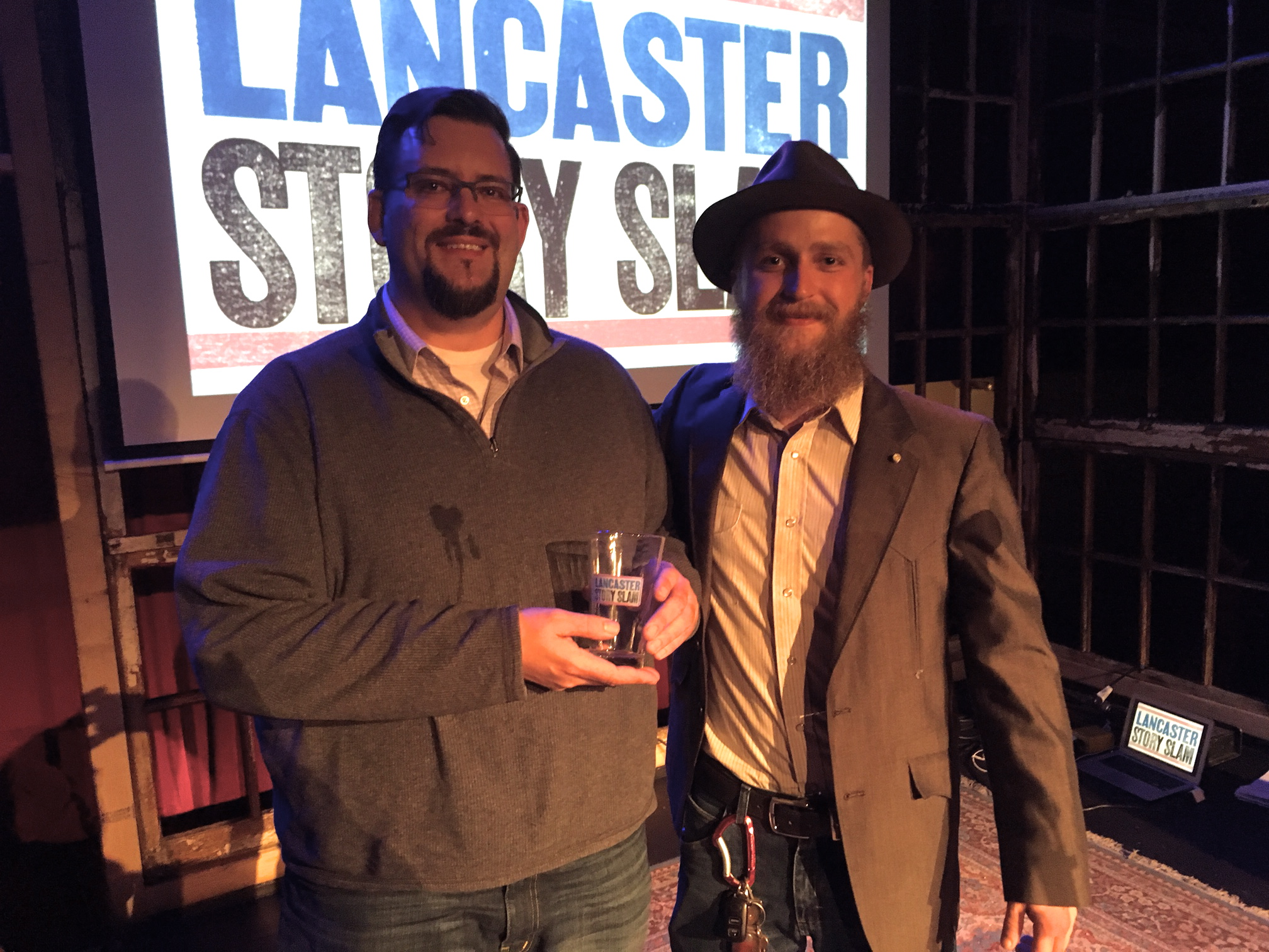 Story Slam winner Matt McDunnell poses with emcee Aaron Lewis