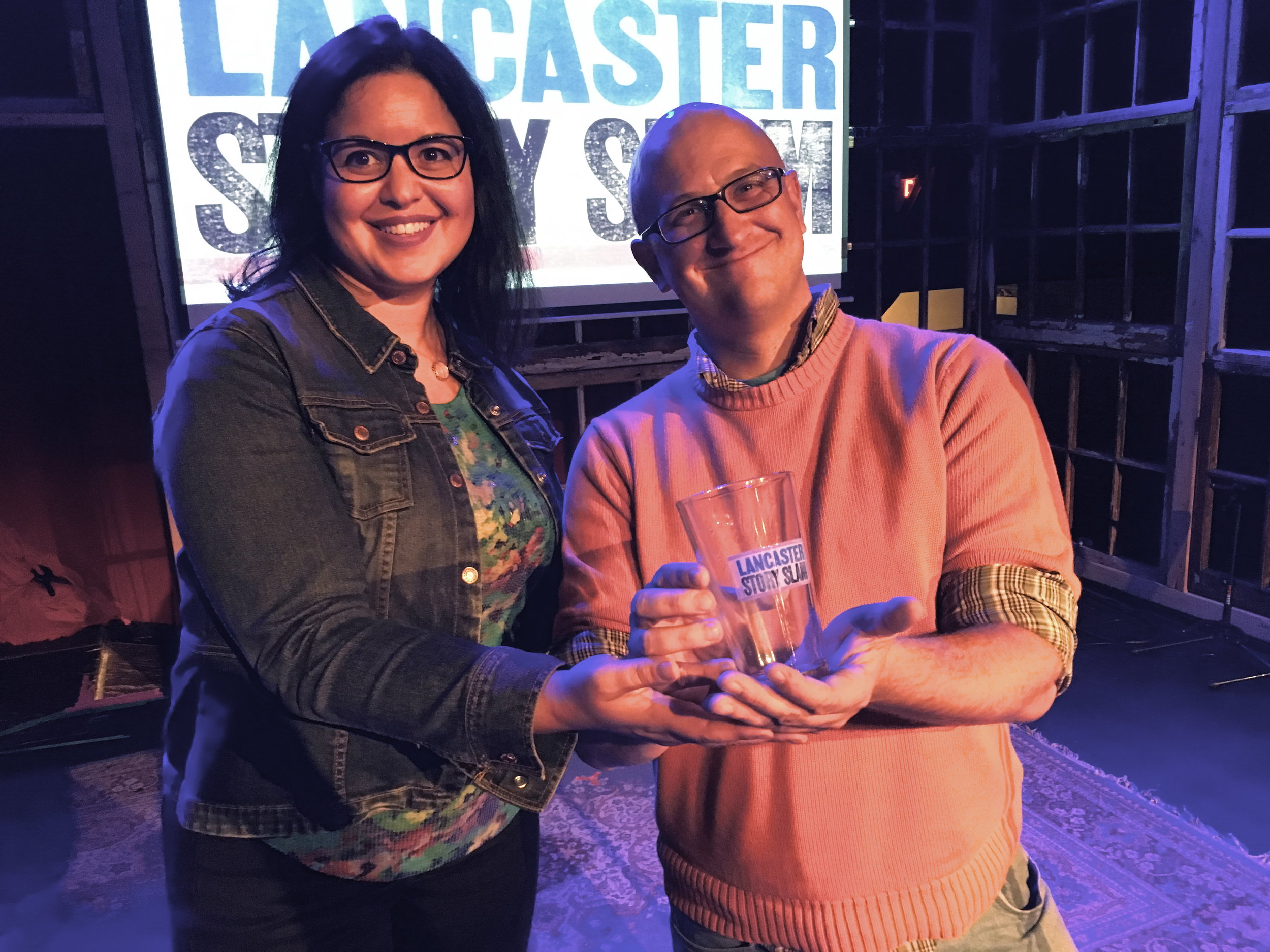 Emcee Meg Martin with winning storyteller Brian William Gish