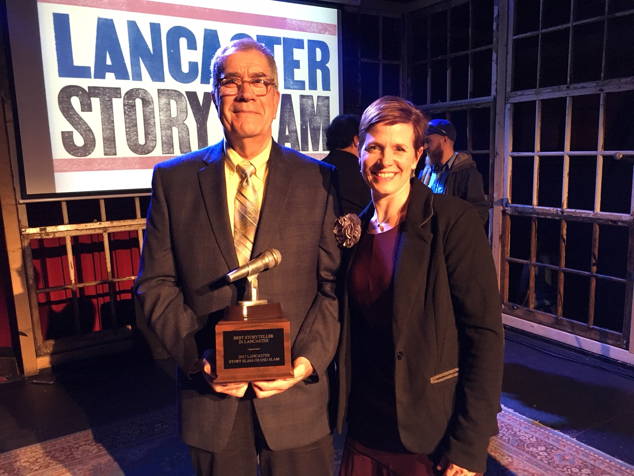 Grand Slam Champion Tony Crocamo poses with Lancaster Story Slam Producer Carla Wilson.