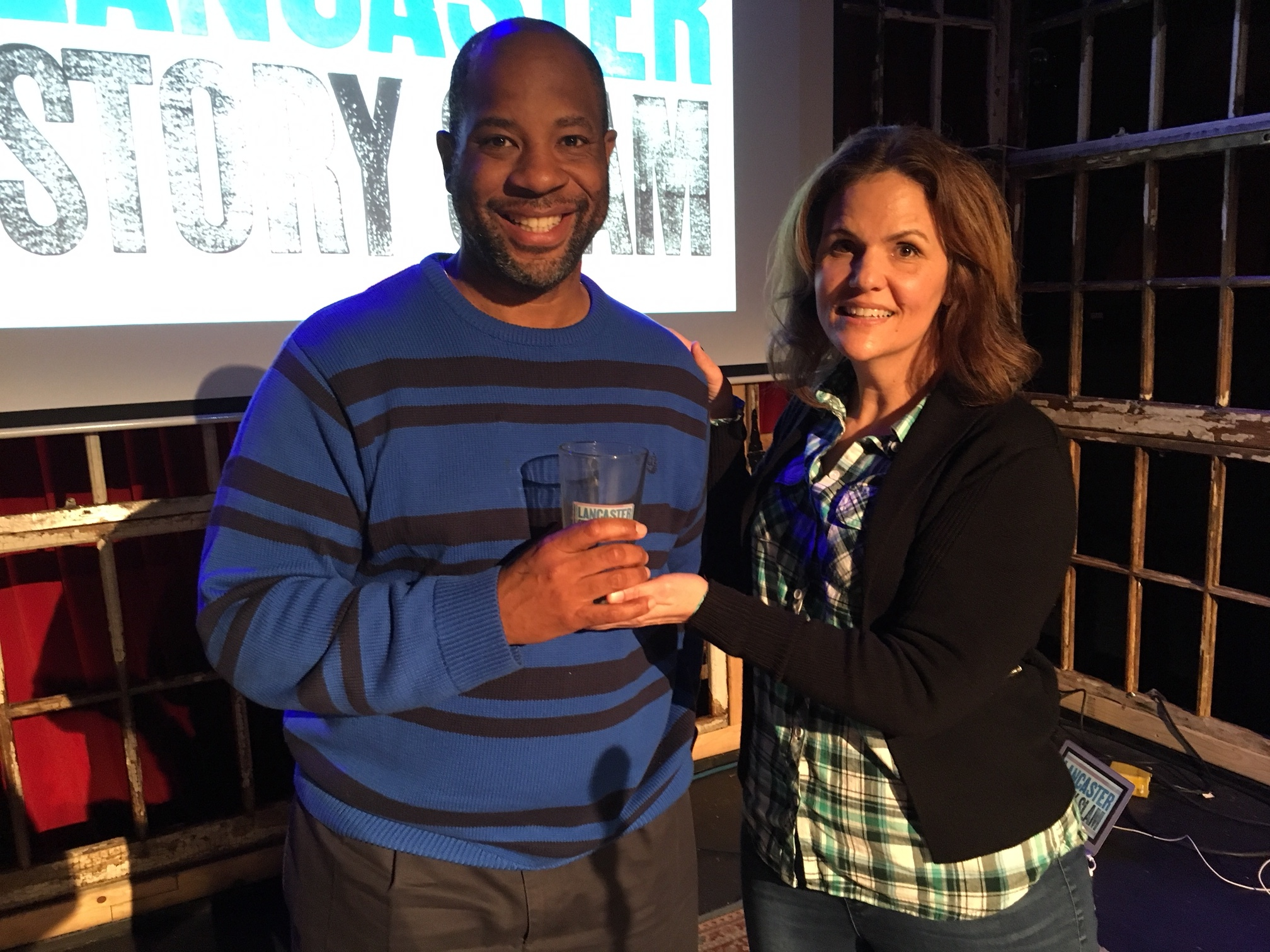 Winning Storyteller Michael Evans poses with emcee Luanne Sims