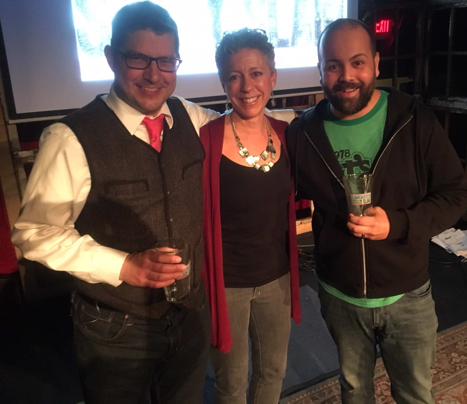 Marcus Grimm, emcee Melissa Snavely and Christian Carrion celebrate!