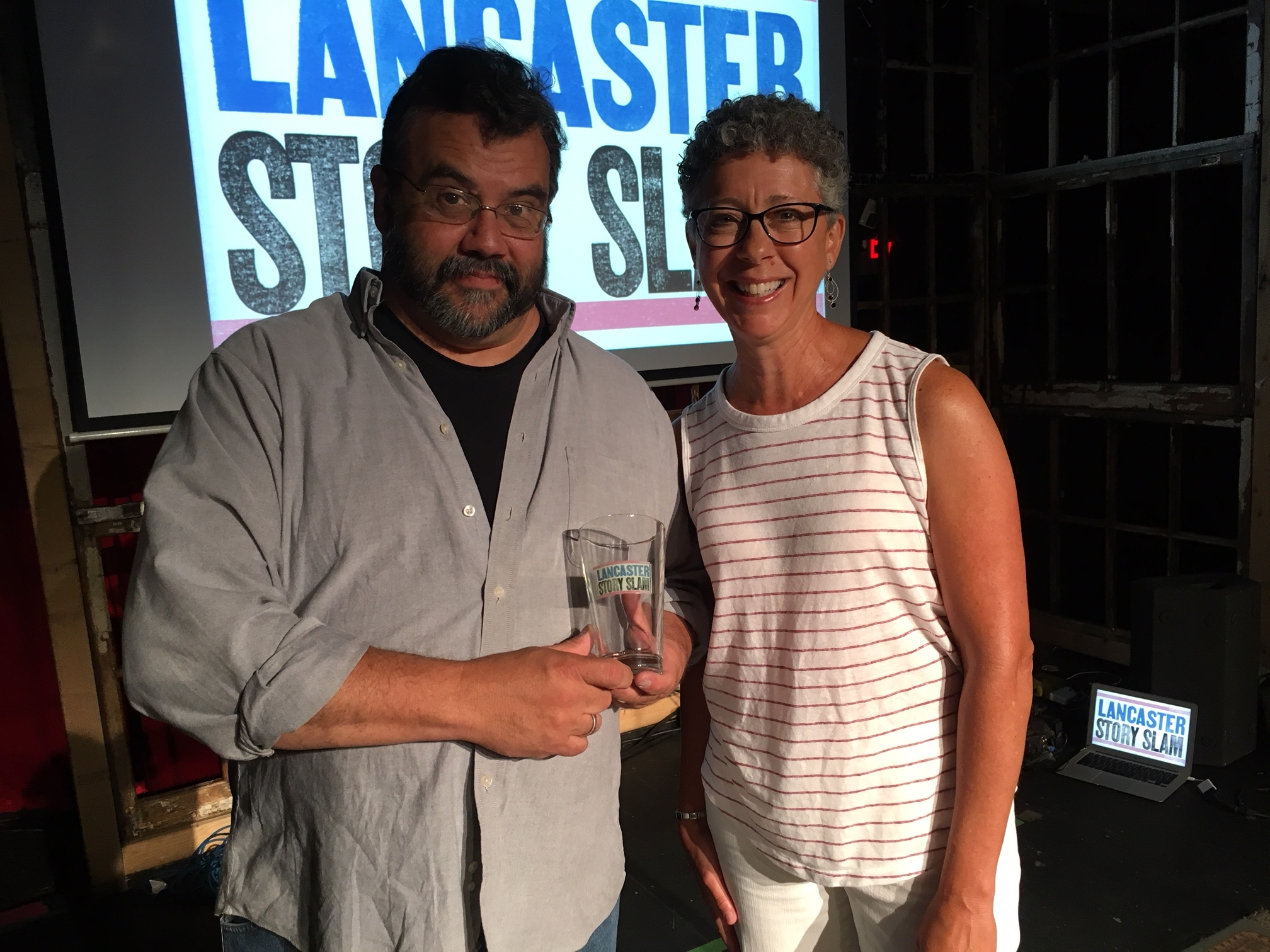 Dave smith poses with emcee Melissa Snavely.