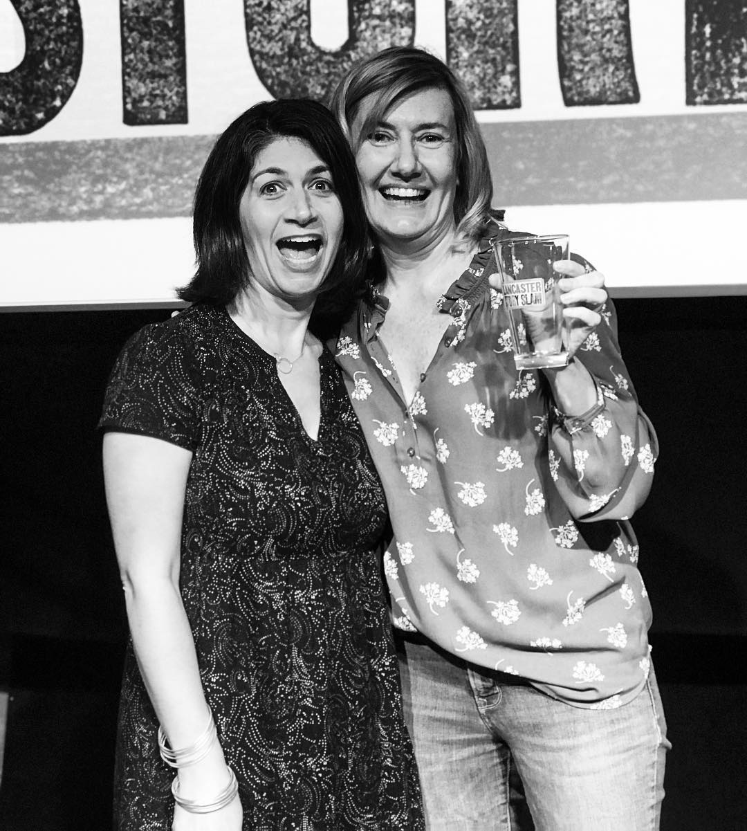Shown above are emcee Jamie Beth Cohen with our April winner, Karen Foerstel, who won the prized pint glass for her 'WTF?' story.