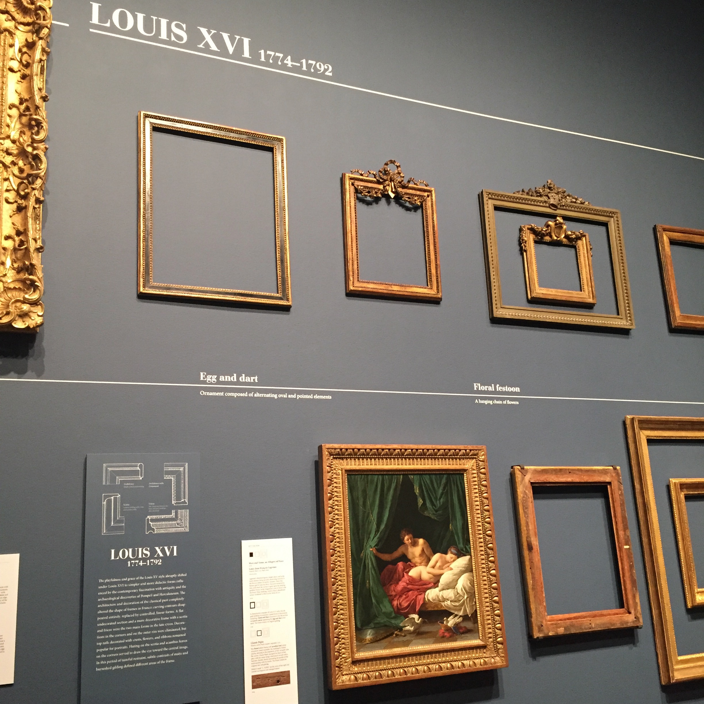 View of restrained, classically-derived Louis XVI frames at the exhibition 'Louis Style: French Frames, 1610-1792' at the J. Paul Getty Museum (September 15, 2015- January 3, 2016)