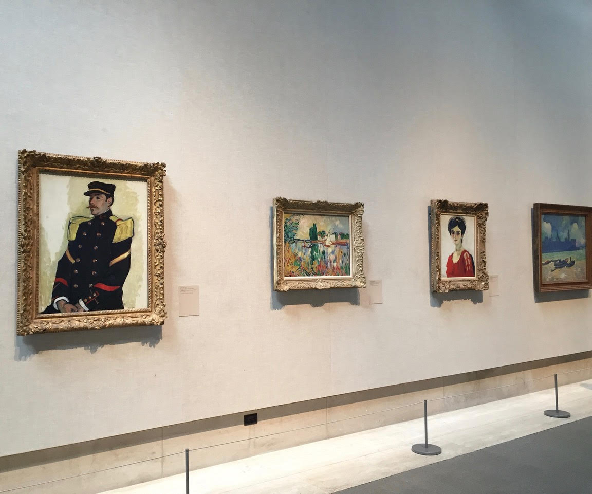 View of French Impressionist paintings in the Lehman Collection at the Metropolitan Museum of Art showing the taste for earlier French 'Louis style' frames.