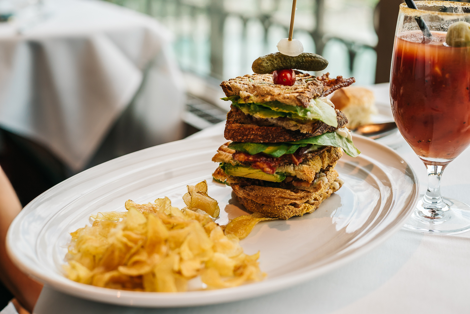 BLT tower sandwich with chips and Bloody Mary