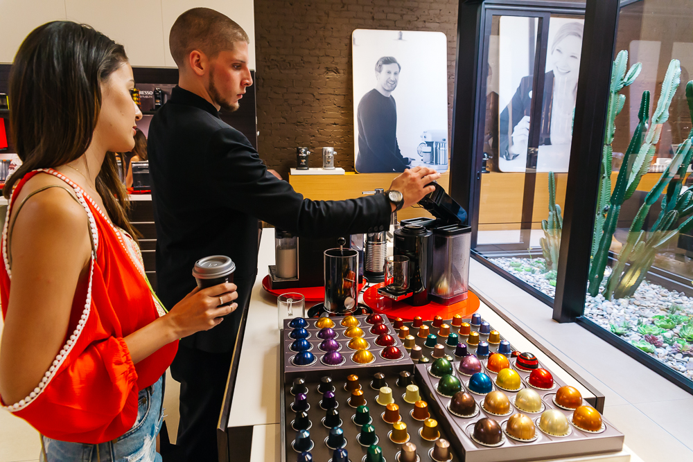 Candy getting a sample of their newest flavor -Envivo Lungo
