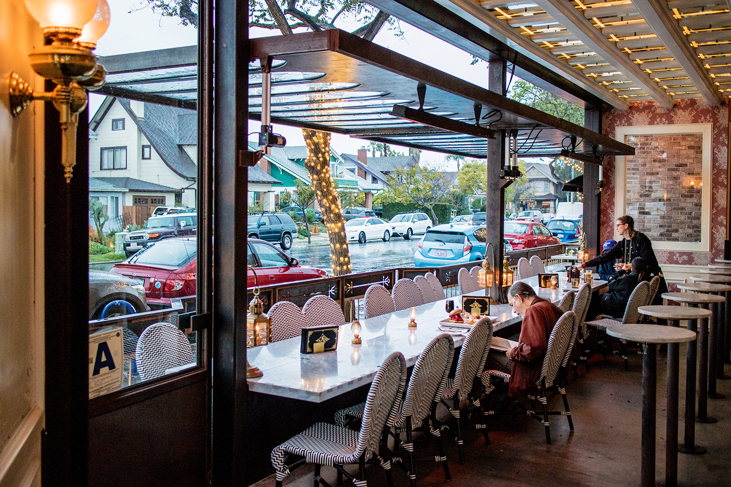 THE WINDOWS OPEN WITH AN INDOOR OUTDOOR SEATING AREA.