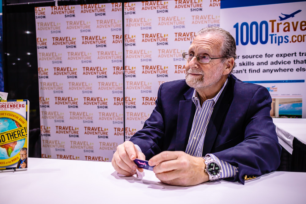 LOOK! PETER GREENBERG IS HOLDING A TRAVEL POCKETS CARD!