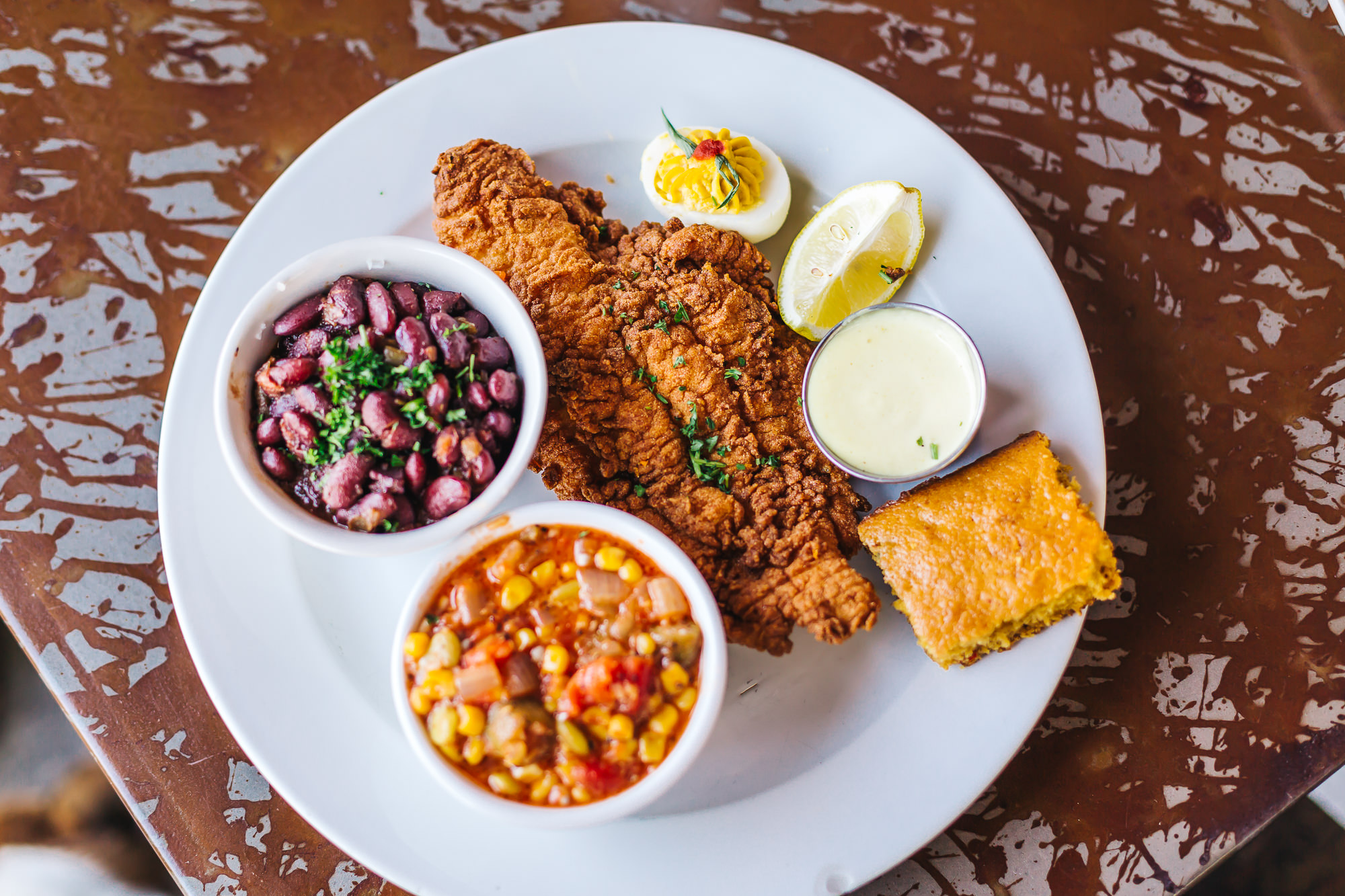 Fried catfish with red beans & rice, okra succotash, cornbread and deviled egg