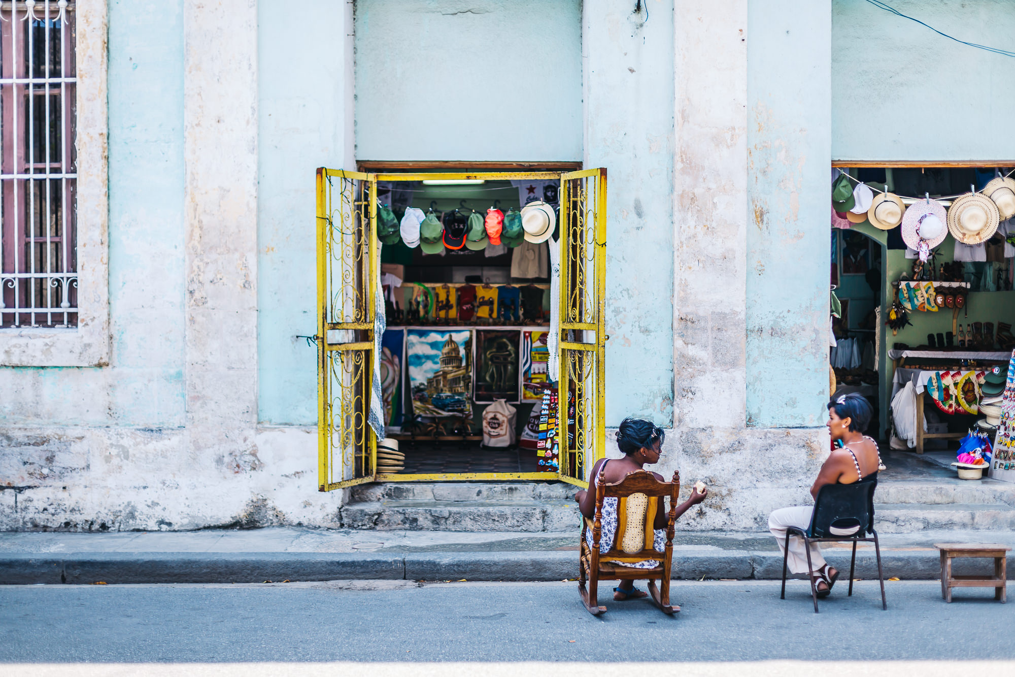 Friendly Cubans having an afternoon chat as they sell items from their shops