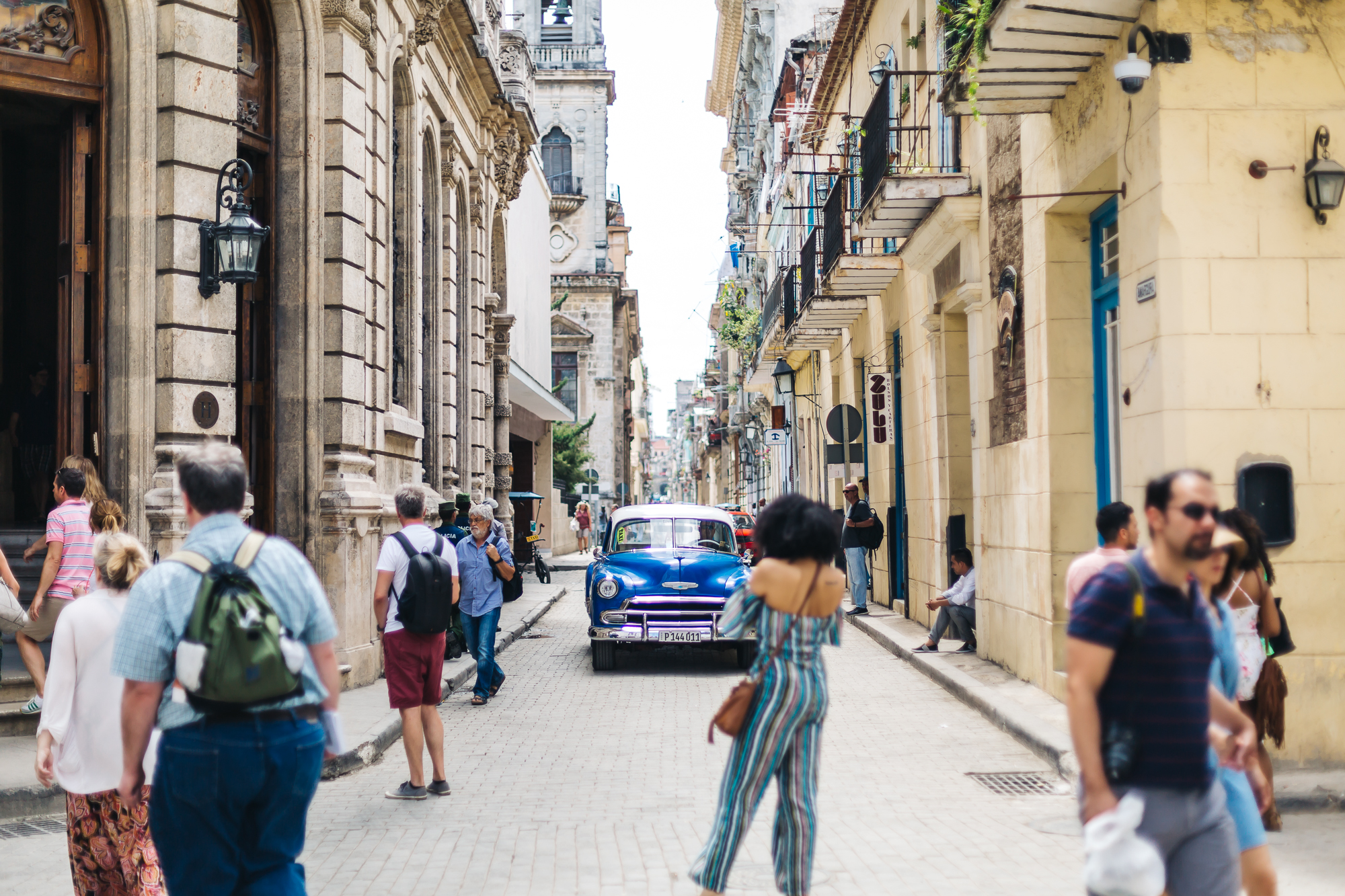 Old classic cars were always surrounded by tourists i n Old Havana