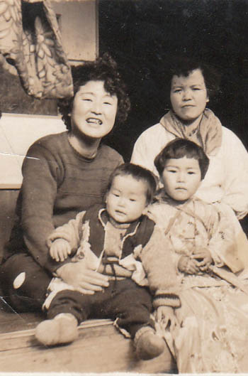 OUR JAPANESE GRANDMOTHER ON THE TOP LEFT. THE LITTLE GIRL IS OUR MOTHER.