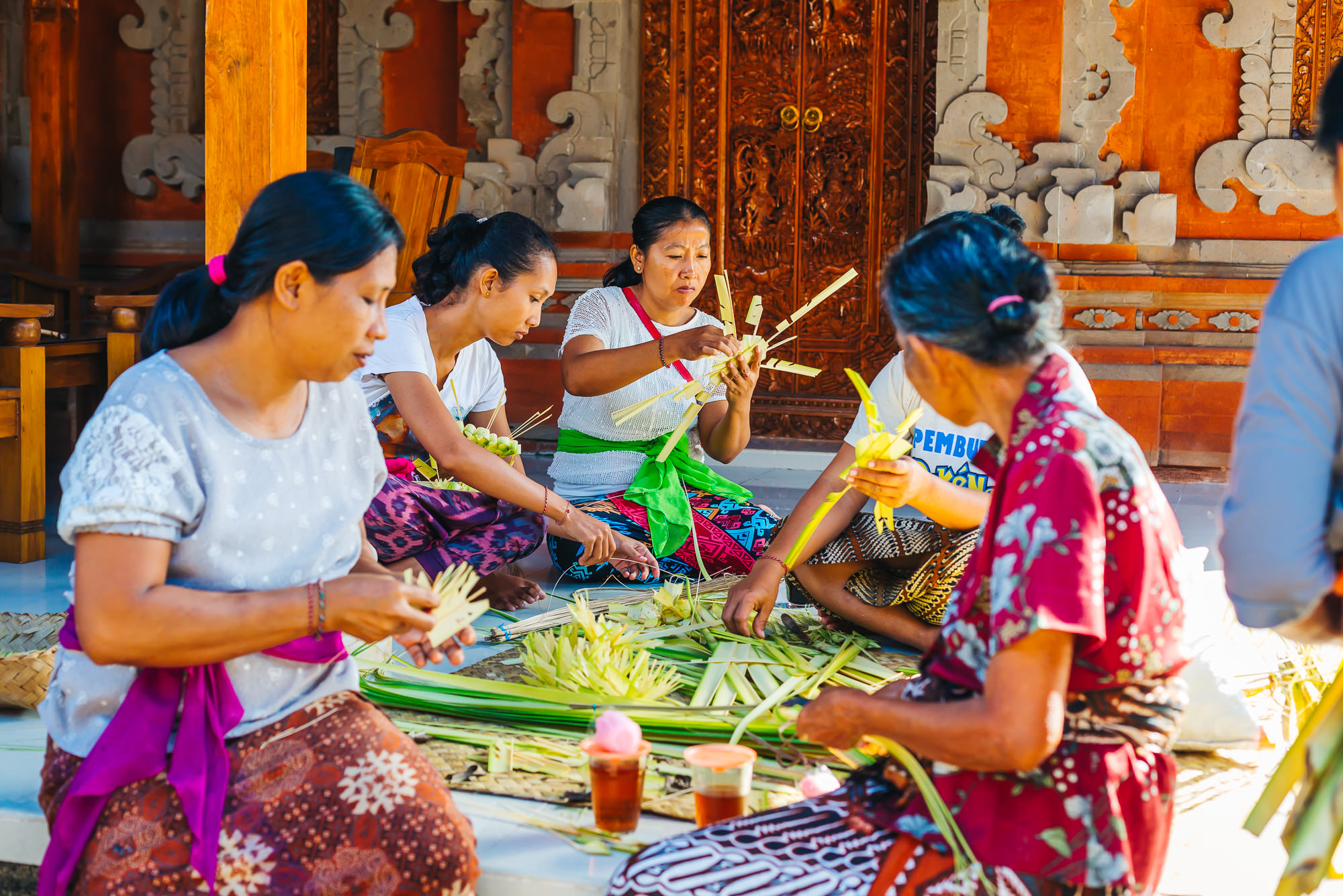 Balinese women creating offerings