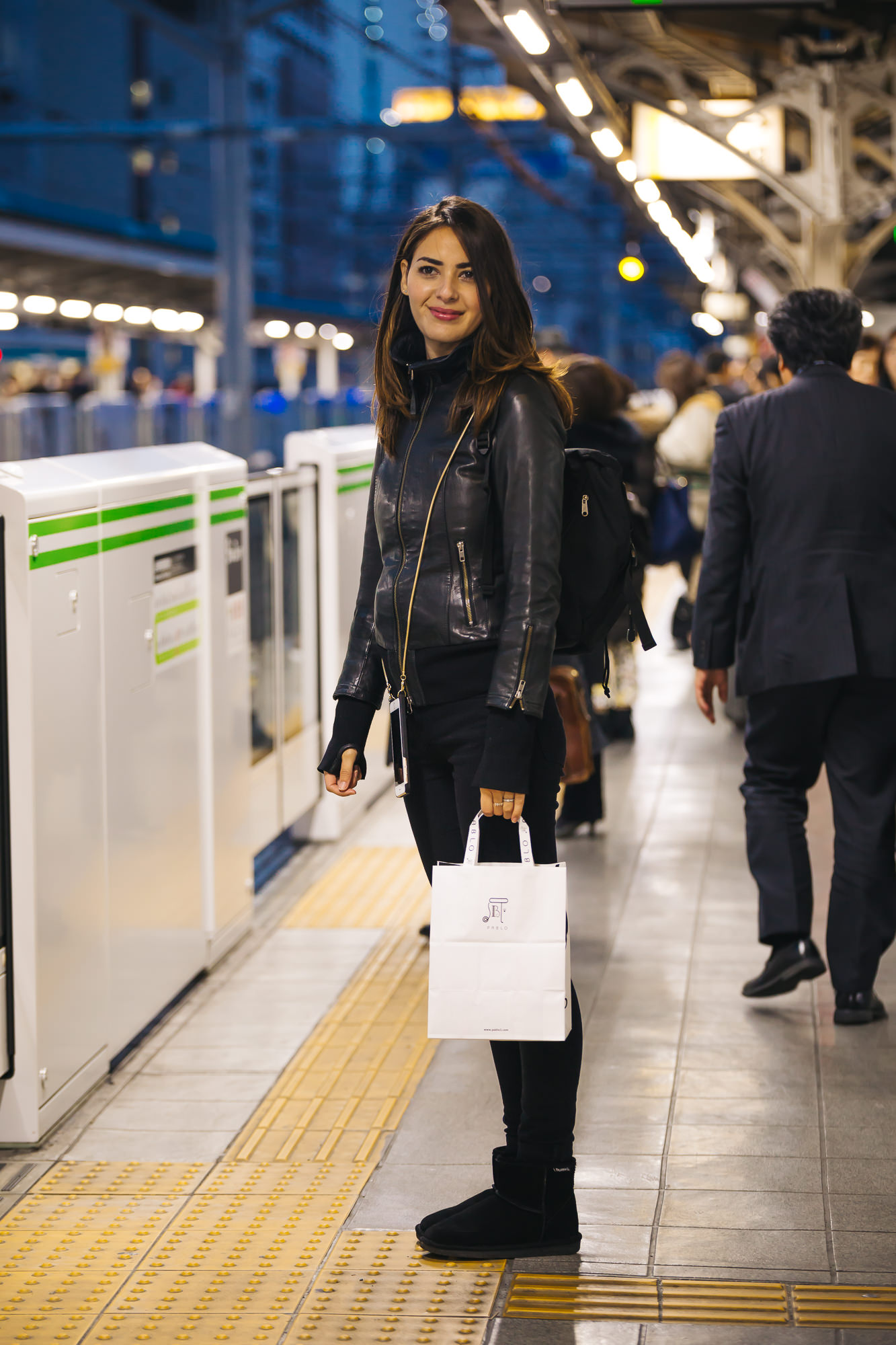 Waiting for the train in Tokyo.