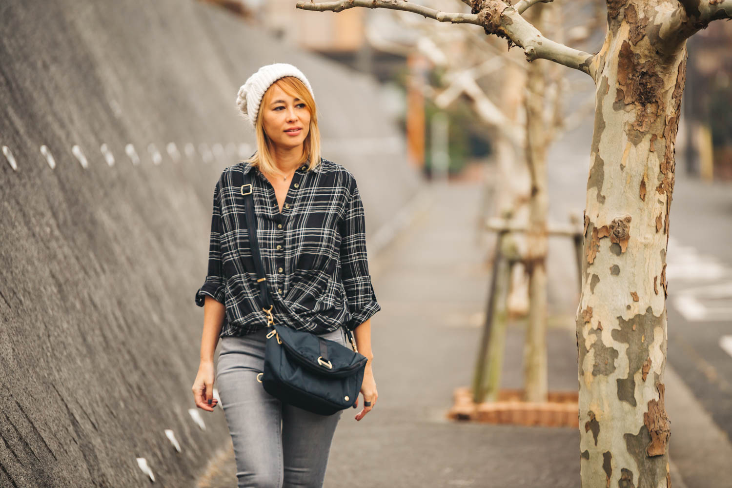 Wearing the  Citysafe CX anti-theft convertible backpack  As A Crossbody Purse