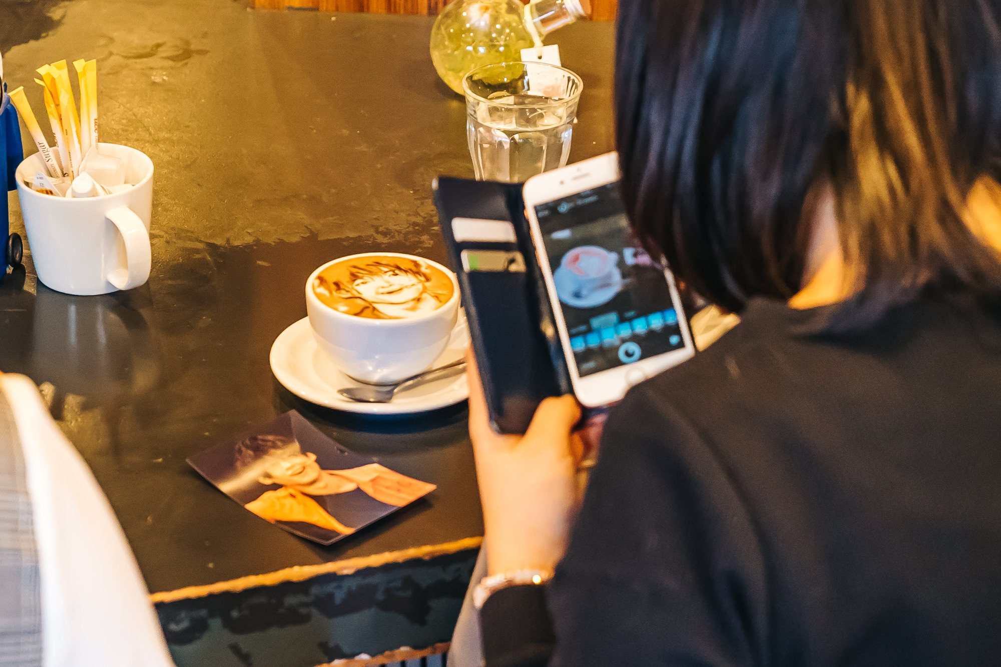 Japanese girls taking pictures of their 2D coffee art