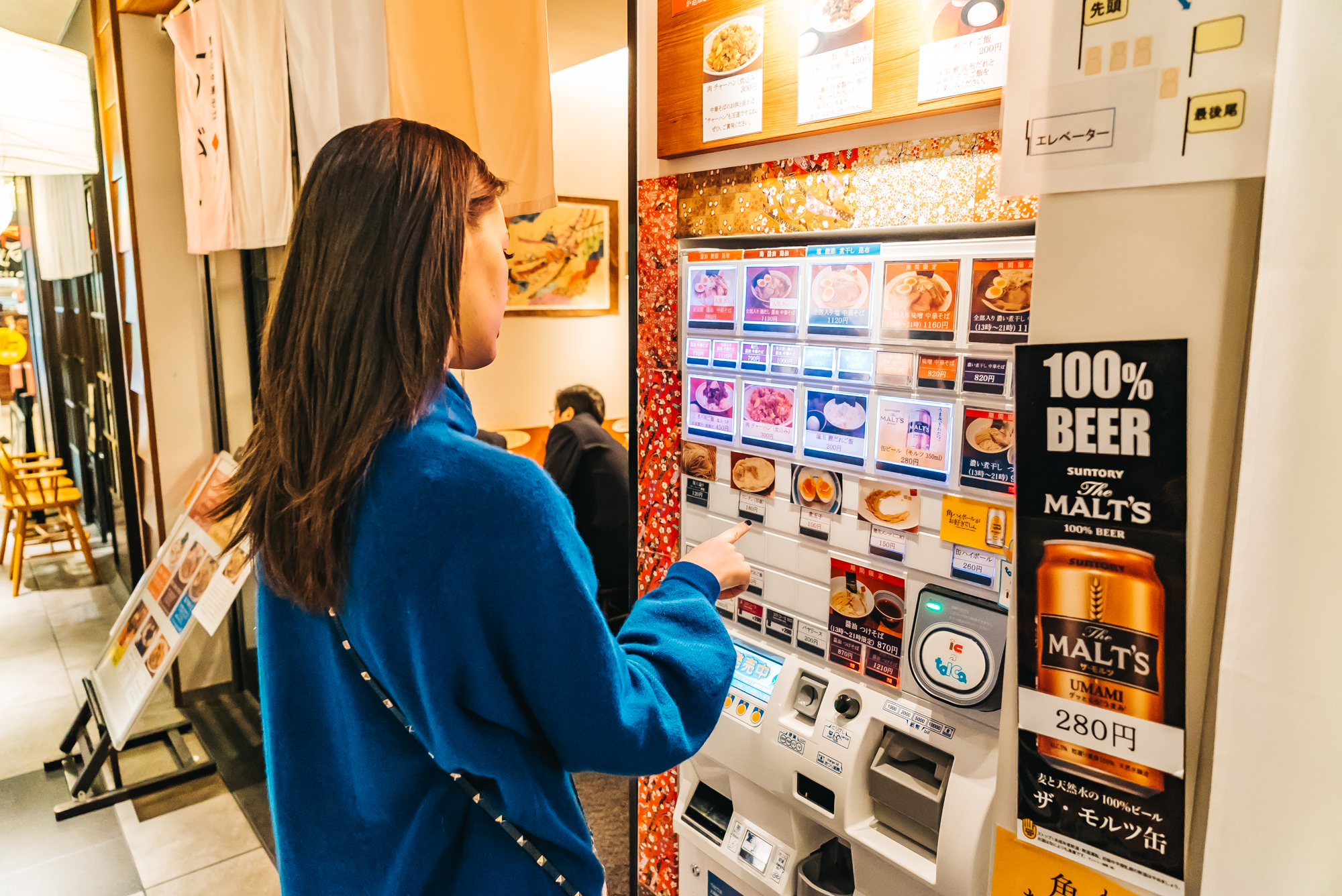 Ordering our ramen through the vending machine first