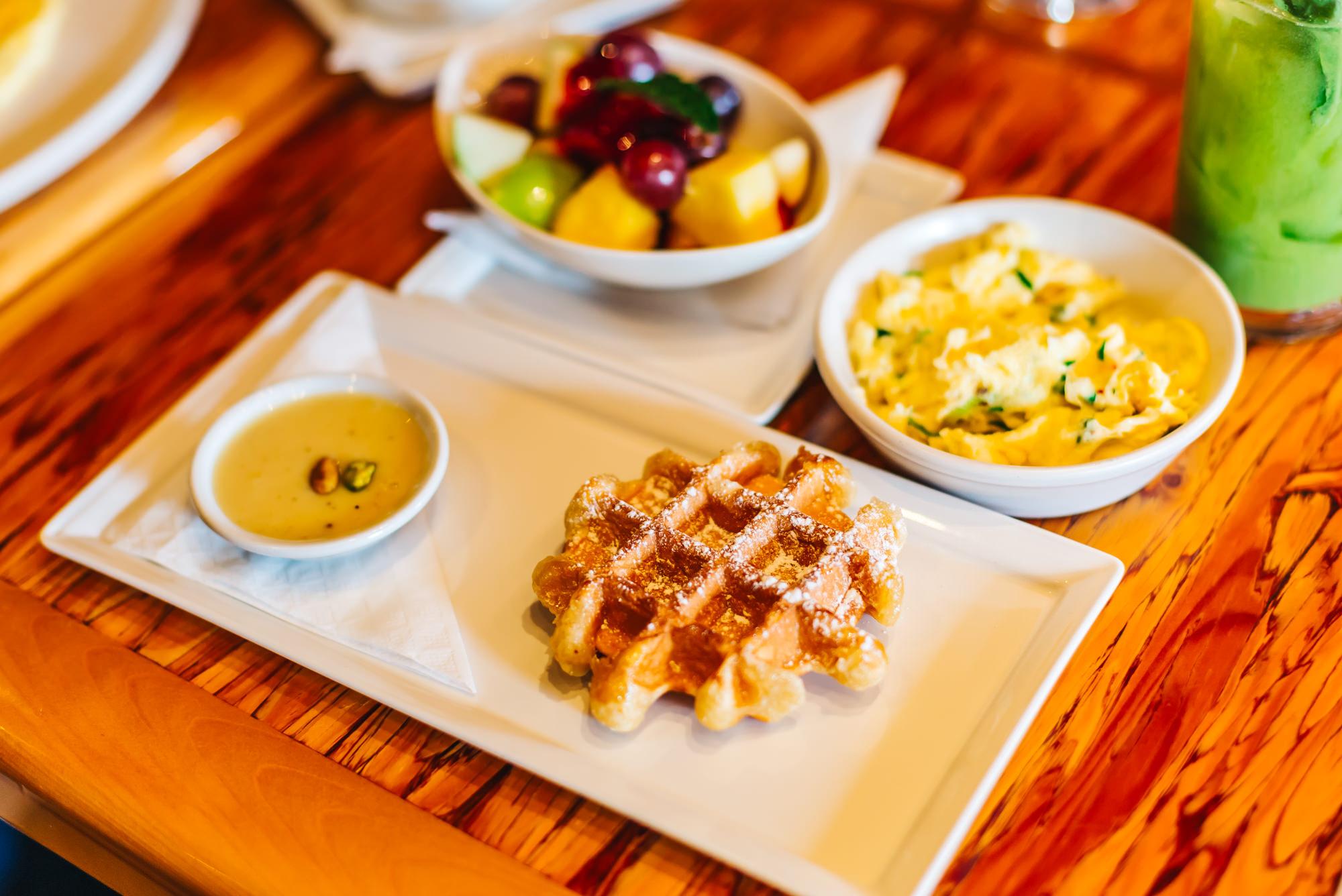 Waffle with White Chocolate Pistachio Rosewater, Free range eggs and Fresh fruit