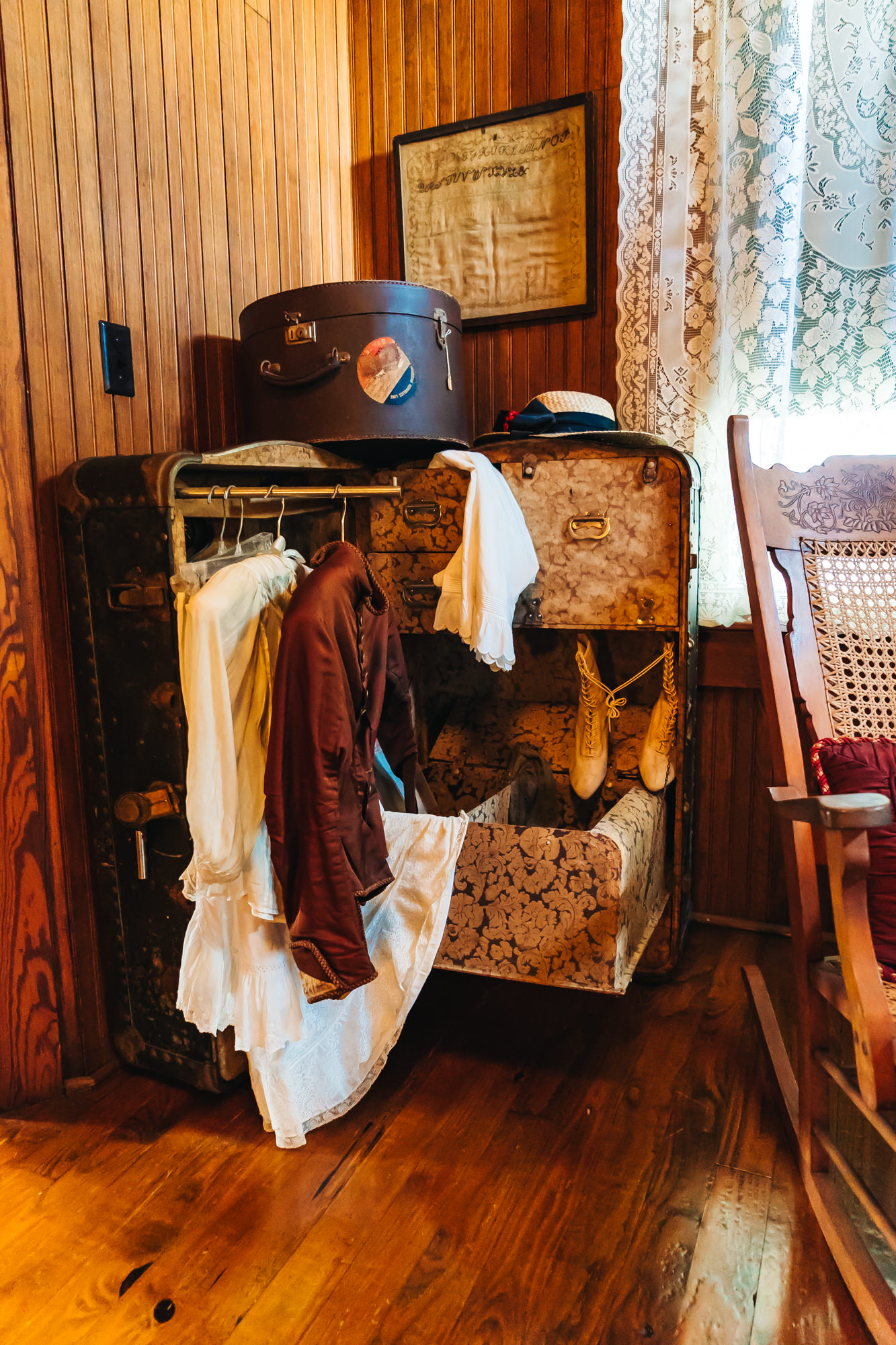 A SUITCASE TURNED INTO A CLOSET IN ONE OF THE GUEST ROOMS