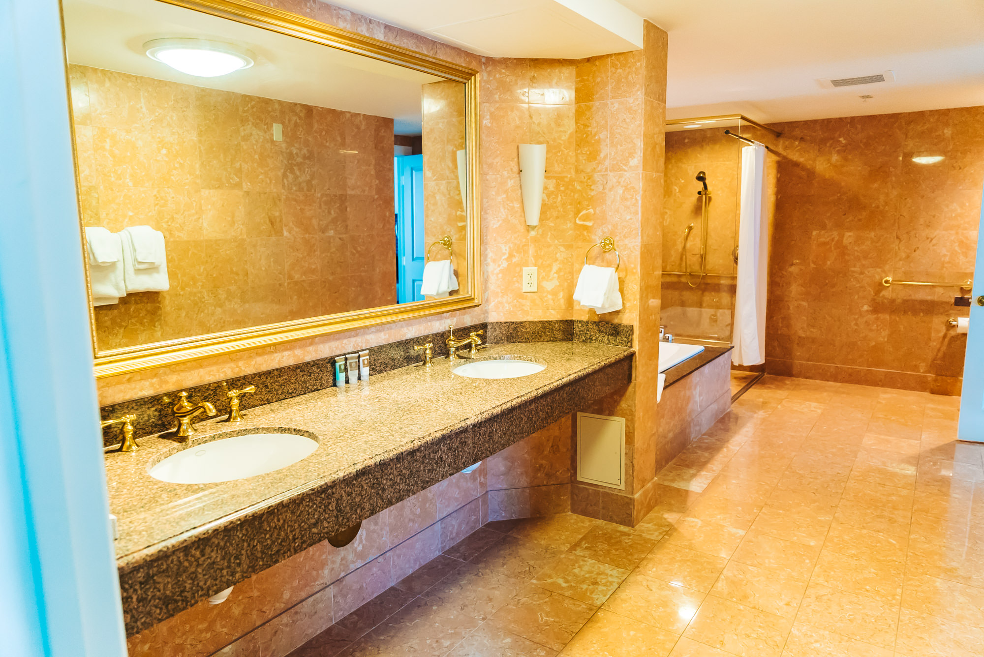 Super spacious bathroom with two sinks, bathtub and shower