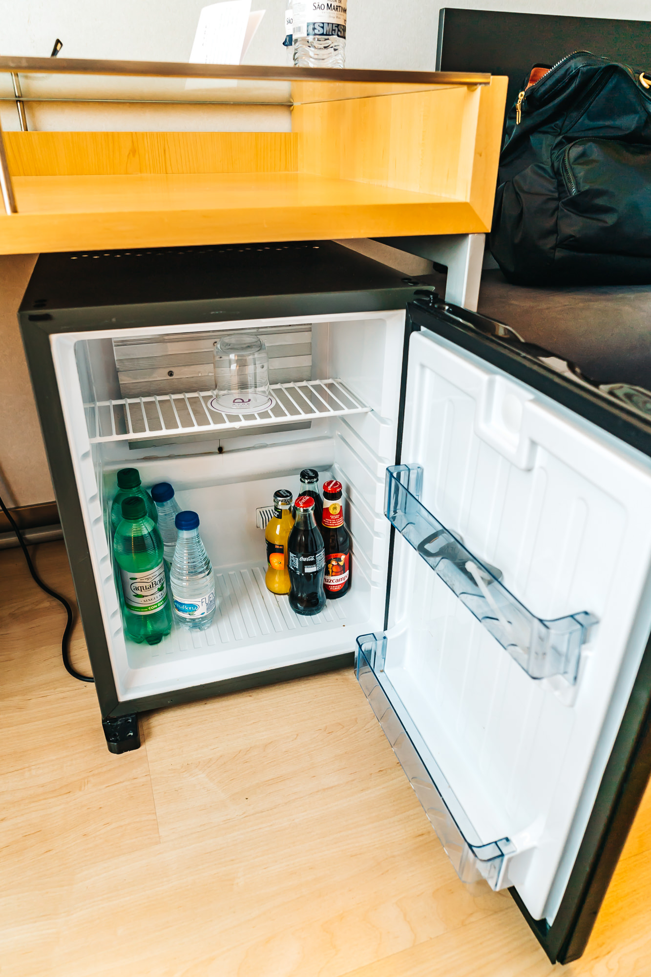 Mini fridge with bottle opener and chilled glass inside