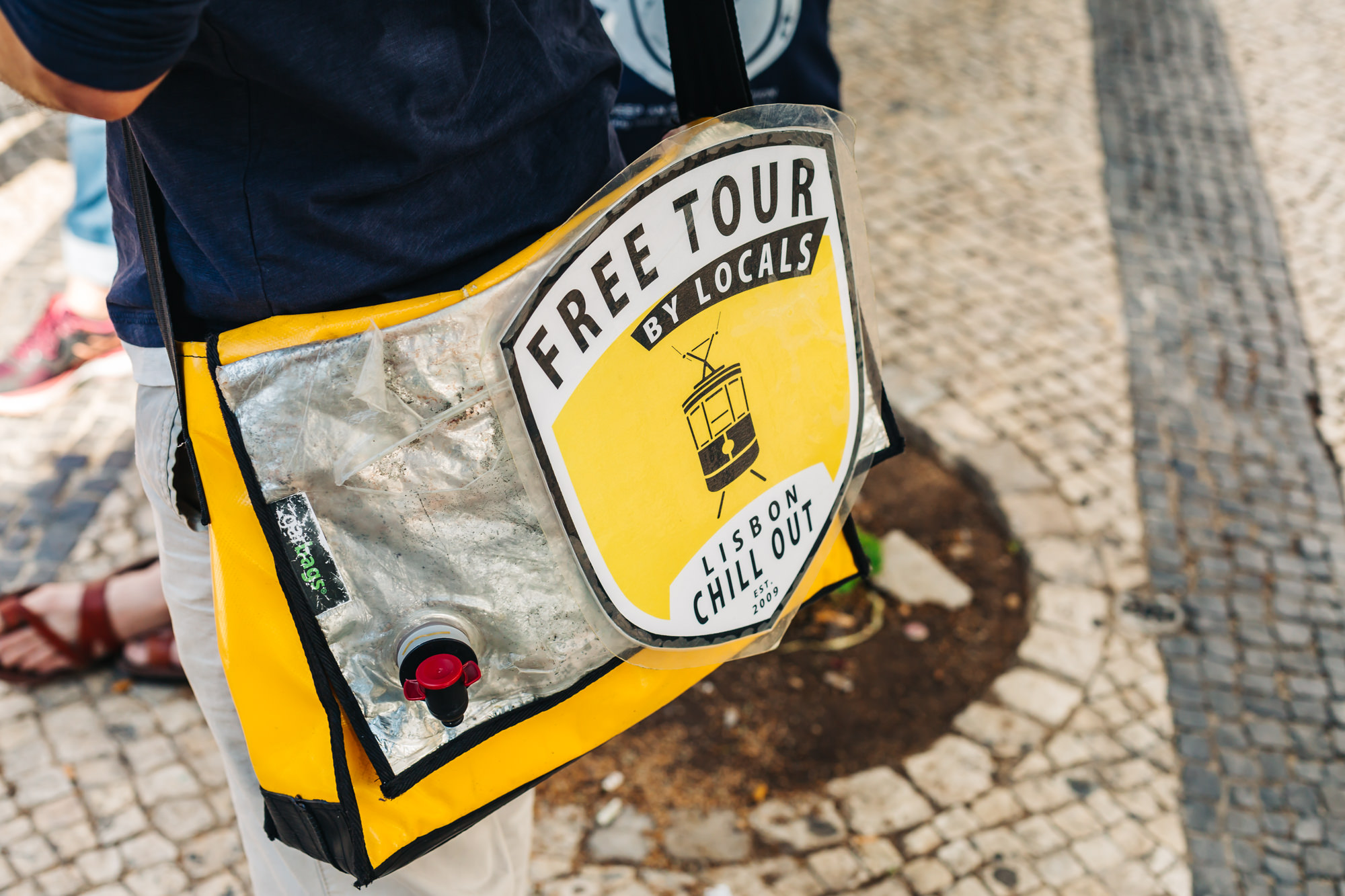 Look for the tour guides wearing a yellow bag