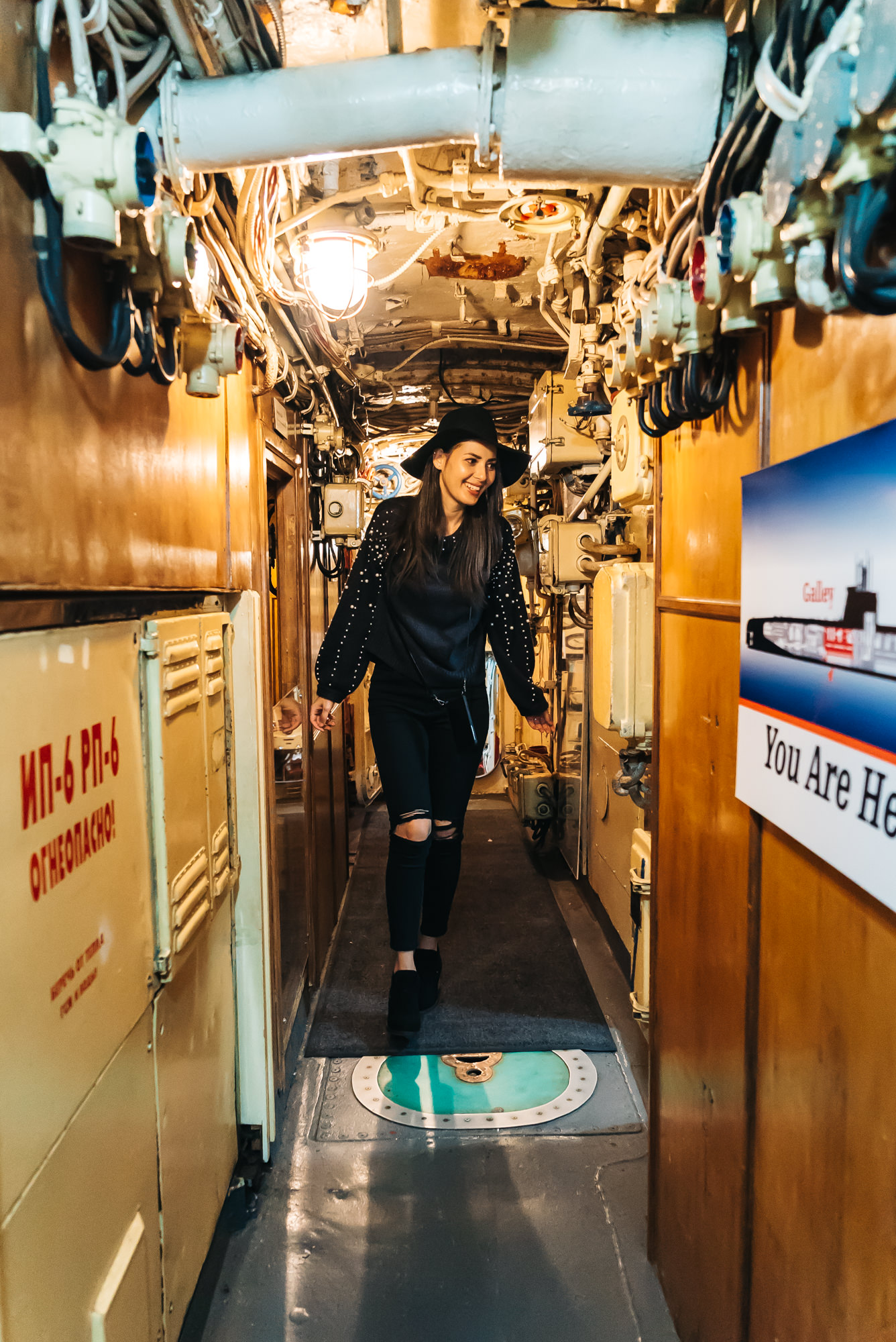 Walking through the narrow hallway of the B-39 Submarine