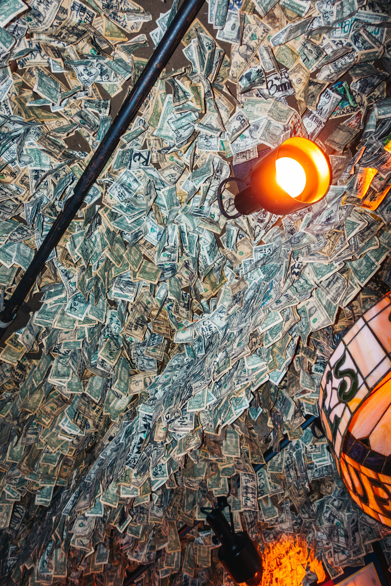 More dollar bills on the ceiling