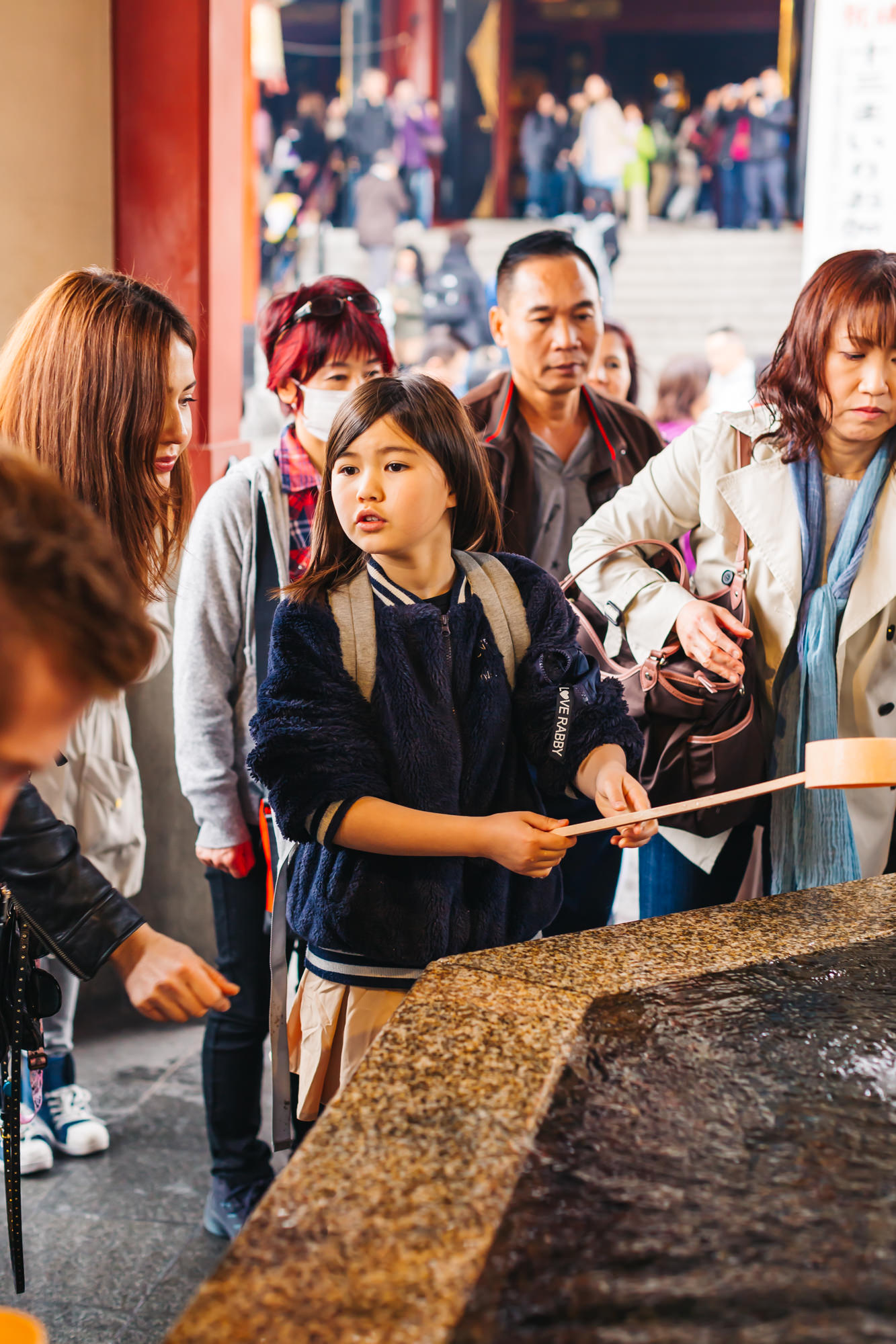 Our niece doing the purifying ritual at the Sensoji Temple