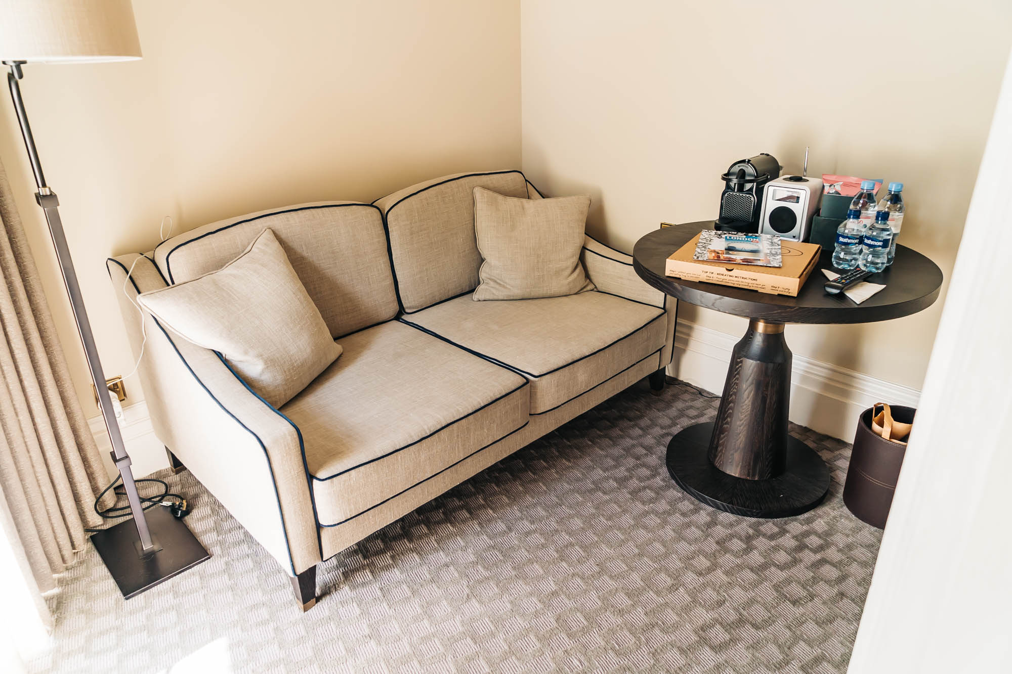 Separate room with a table, sofa and TV