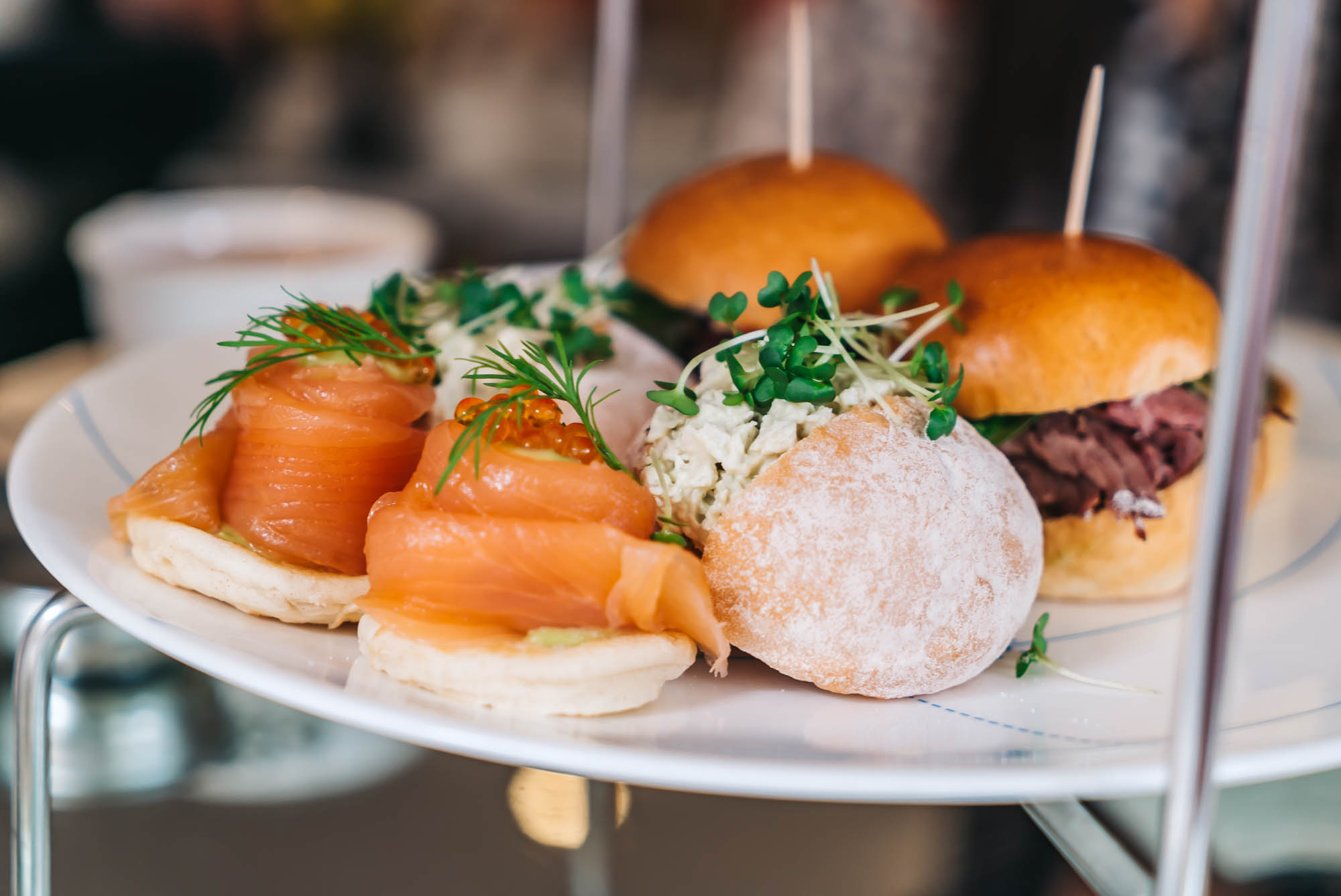 Smoked Salmon & Avocado on Blinis, Brioche with Roast Beef, Watercress, Cornichons, and Chicken with Basil & Lemon Mayonnaise on a Bun
