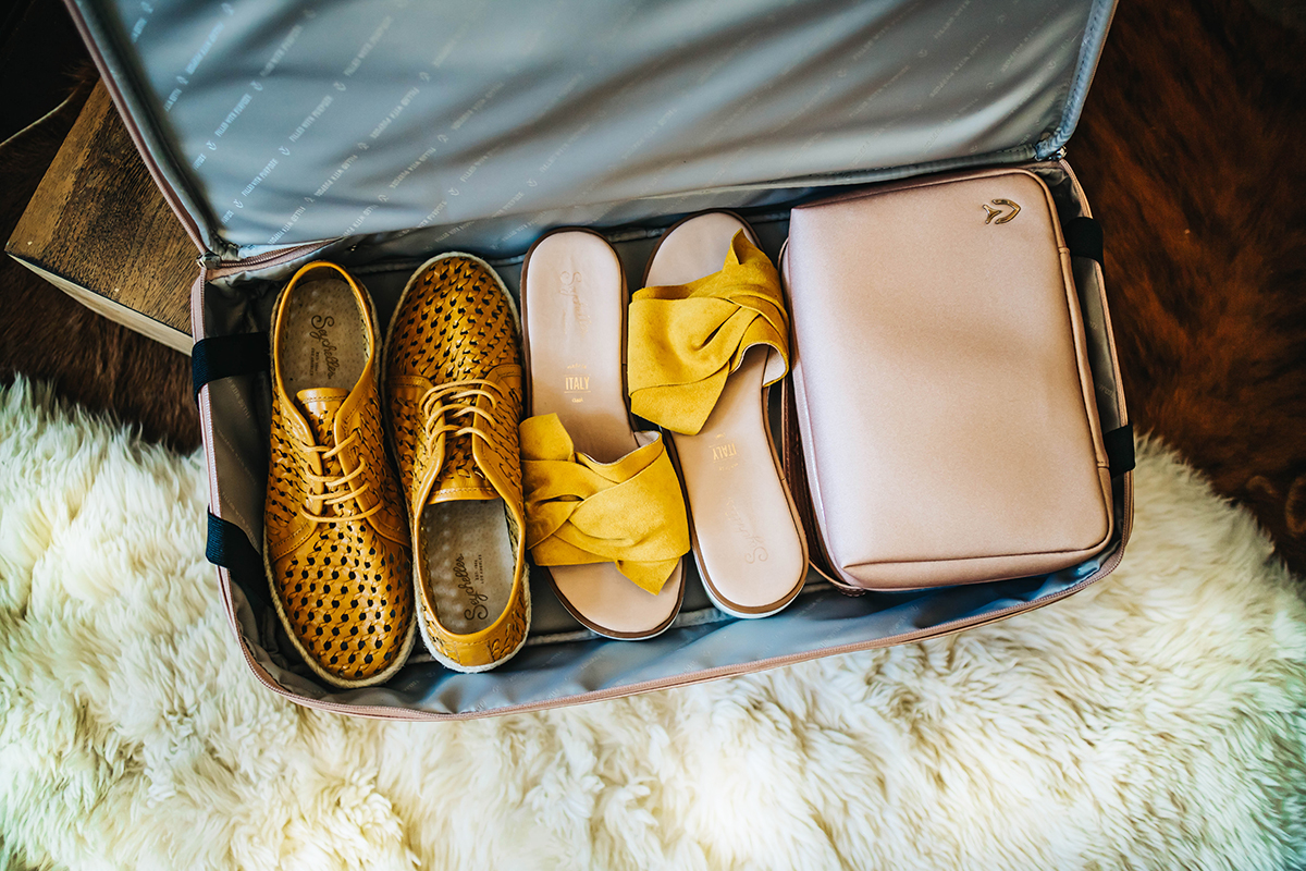 I was able to pack two pairs of shoes and a toiletry bag in the bottom compartment. Sneakers & Sandals from   Seychelles Shoes