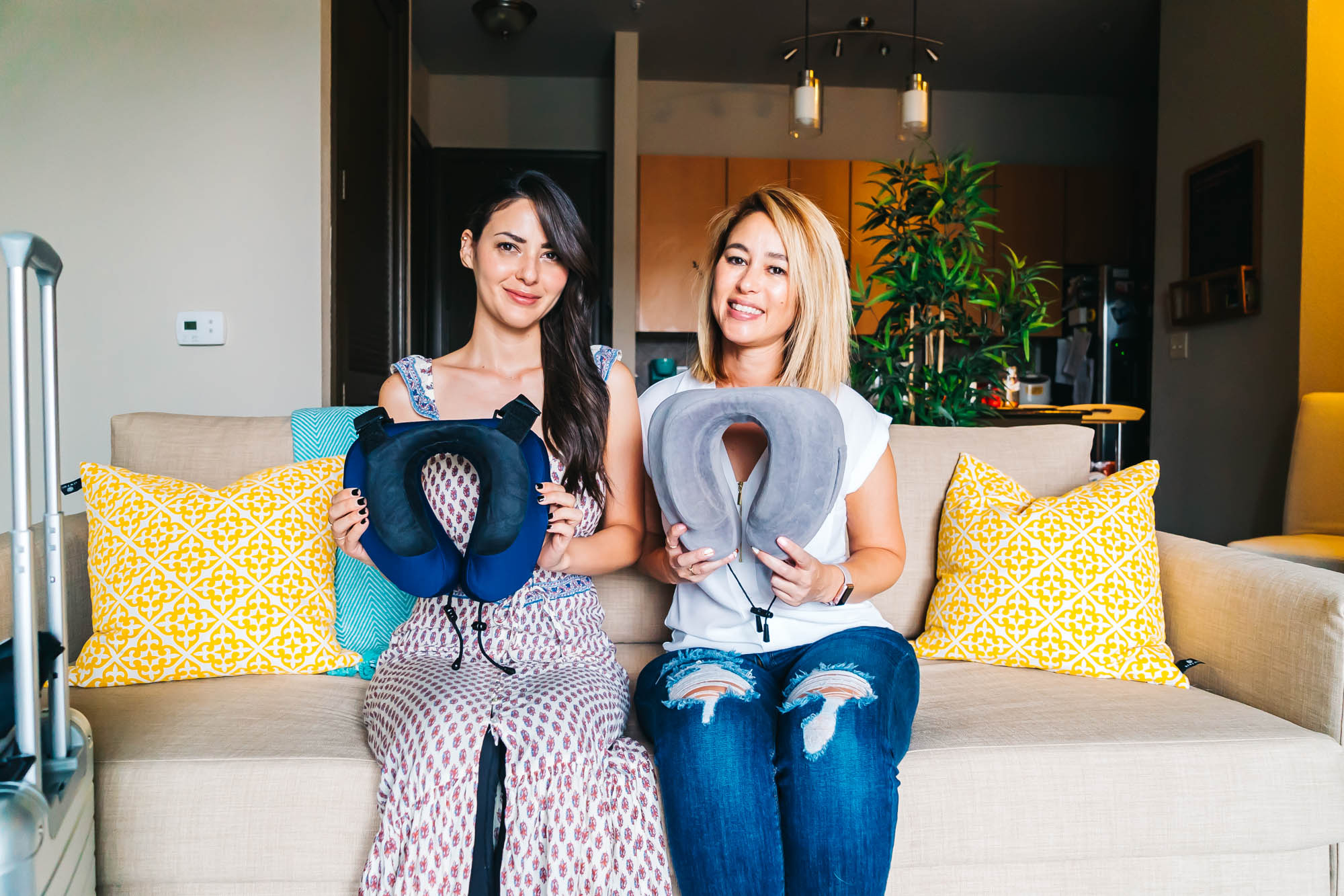 Candy holding the   Cabeau Evolution S3 Travel Pillow   and Crystal holding the   Cabeau Evolution Classic Travel Pillow