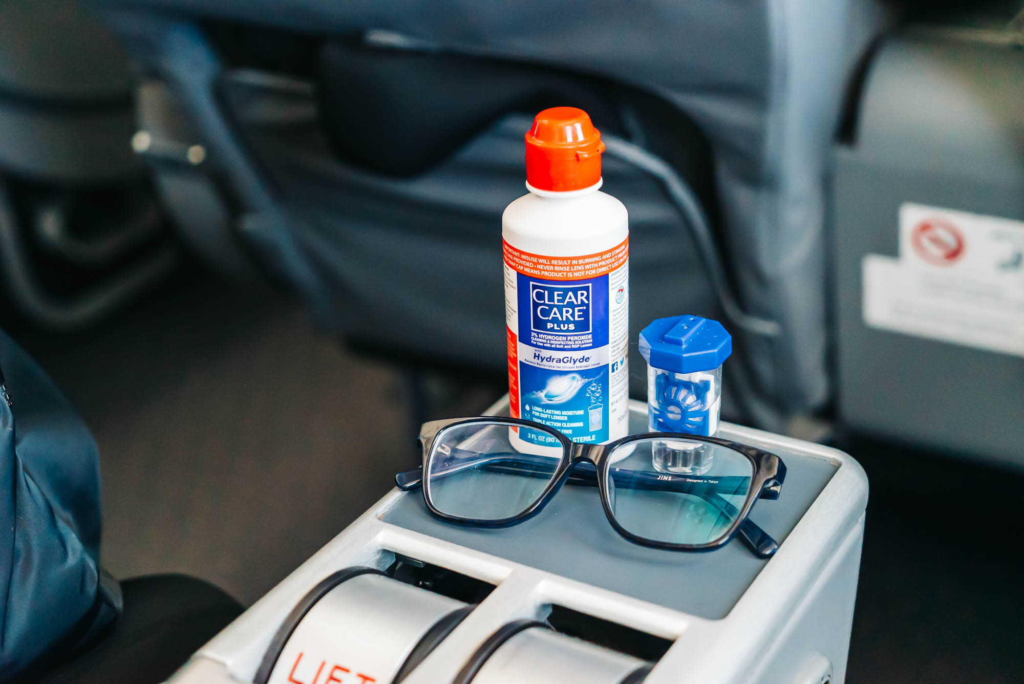 Contact Lens Solution and Glasses