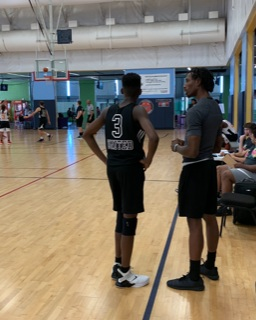 Coach Mo tells 6'3 freshman PG and floor general Conner Ivy (BCP) what play to run after the free throw. (8/10/19)