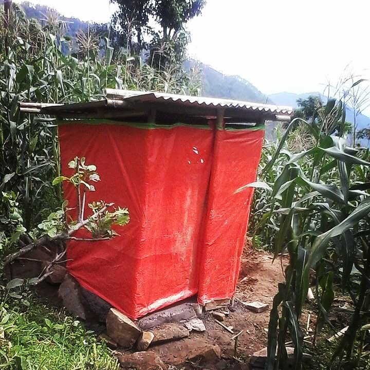 In #Karmidanda, the #SpanishRedCross worked with local leaders to build 5 of these emergency toilets around the village. Others have reconstructed their old outhouses or share with neighbors. #SafeSanitation for all! #NepalEarthquake #DisasterRelief #WASH #RebuildKarmidanda #GoodStart #LongWayToGo