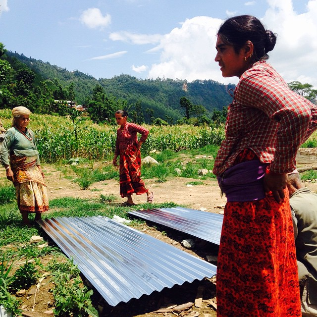 Here's a few ladies ready to carry sheets of tin back to their houses. Thanks to your generous donations, every family in #Karmidanda now has enough tin to build a new roof! #NepalEarthquake #EveryBitCounts #SafeShelter #TemporaryStructure #GranniesForTheWin #RebuildKarmidanda