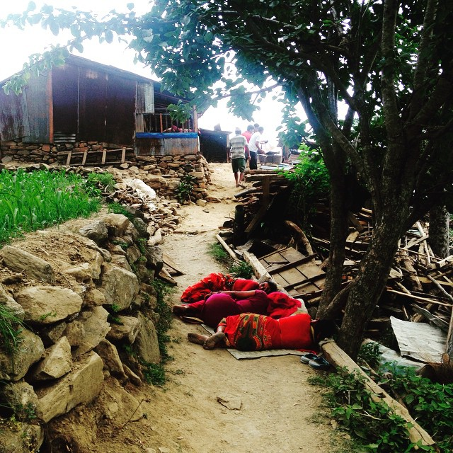 Some ladies snoozing in the shade in blazing hot #Karmidanda. The locals have done what they can, the government has given us their blessing, and we've mobilized the NGOs to our area. Nat and I arrived in Kathmandu today to start filling in the gaps. #NepalEarthquake #ComeTogether #BabySteps #ItsGettinHotInHere #RebuildKarmidanda