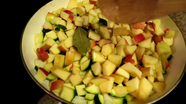 1. Heat a large, deep skillet over medium to medium-high heat with 5 tablespoons coconut oil. Then add bay, apples, 1/2 of the onion and zucchini. Season the vegetables liberally with salt and pepper. Cook 10 minutes or until softened.