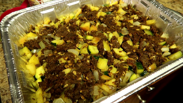3. Dampen the stuffing with vegetable stock. Pile the stuffing into a serving dish. Place in oven to just crisp up the top.Voila!