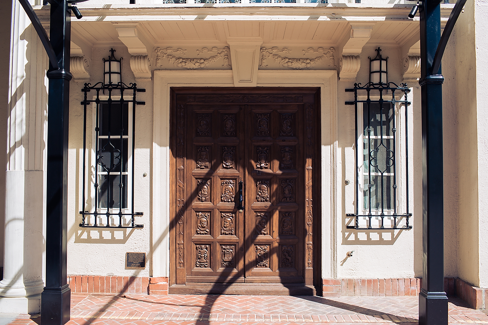 These hand-carved doors feature the likeness of important people of the late 1800's and early 1900's
