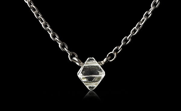 Double pyramid diamond on a white gold chain necklace.
