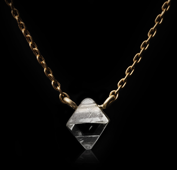 Octahedron diamond on a gold loop chain necklace.