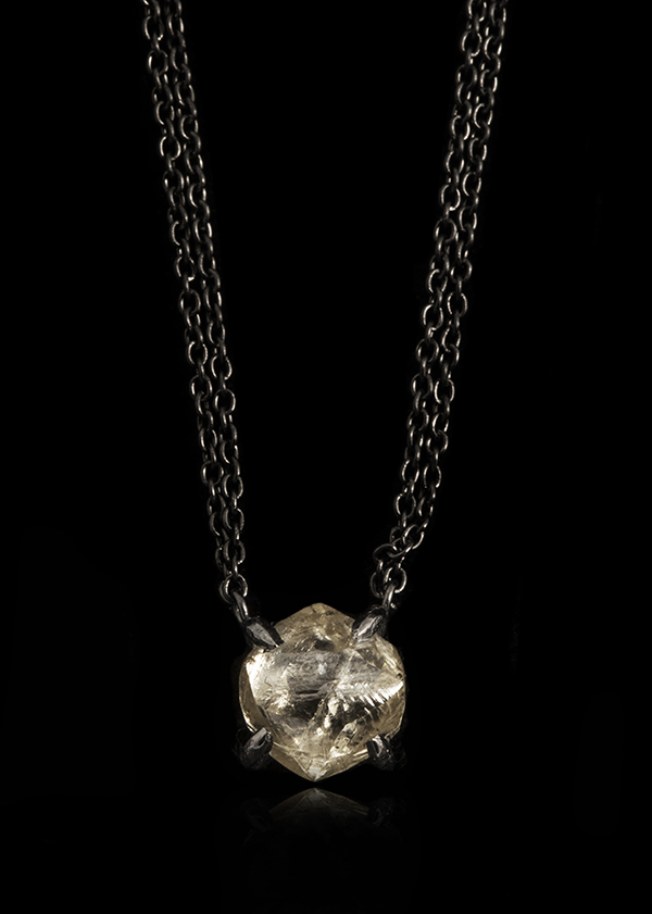 Big diamond in two black rhodium chains set as a necklace.