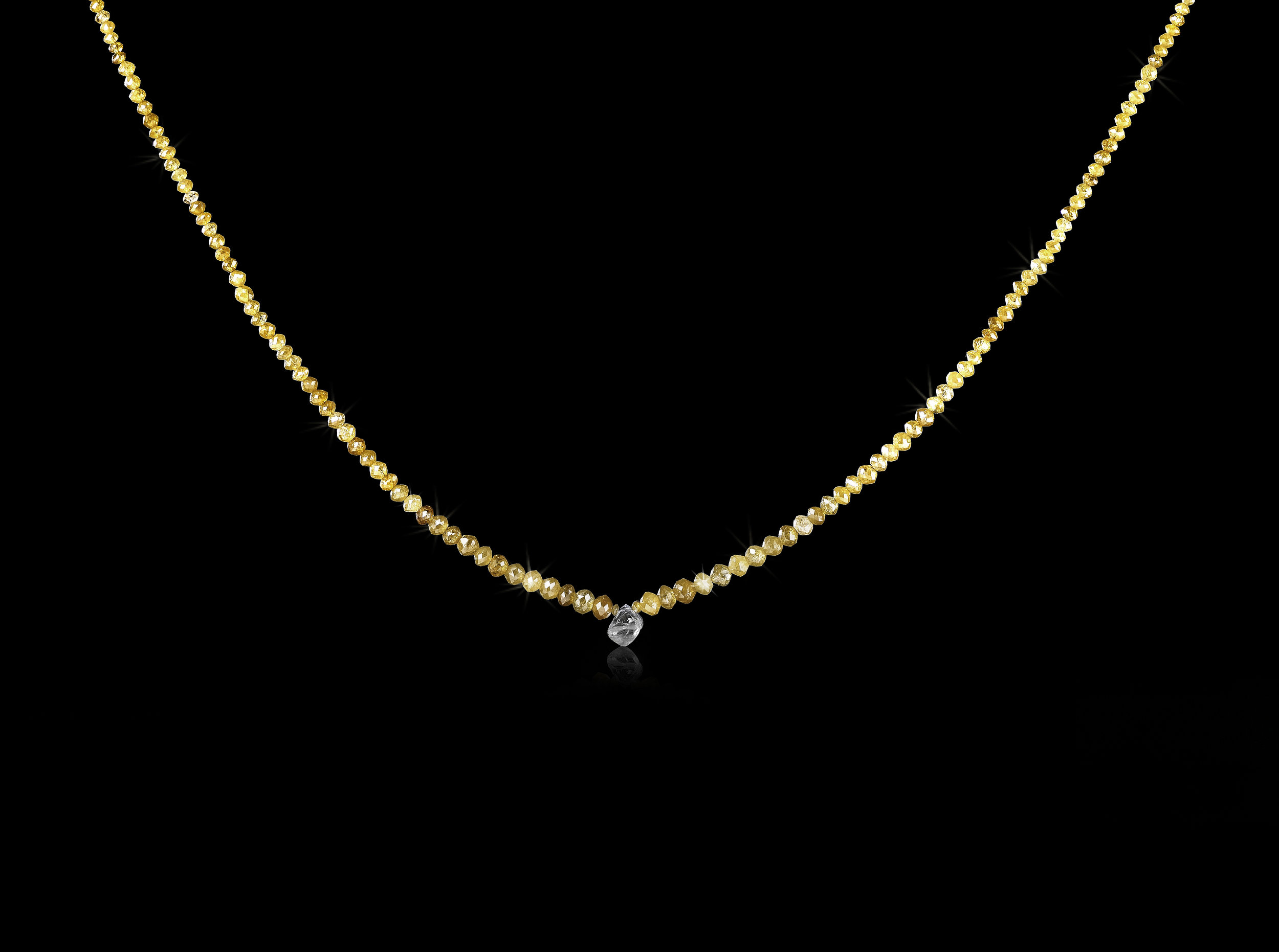 1.13 ct. rough diamond & 20.09 ct. yellow facetted diamonds in a collier