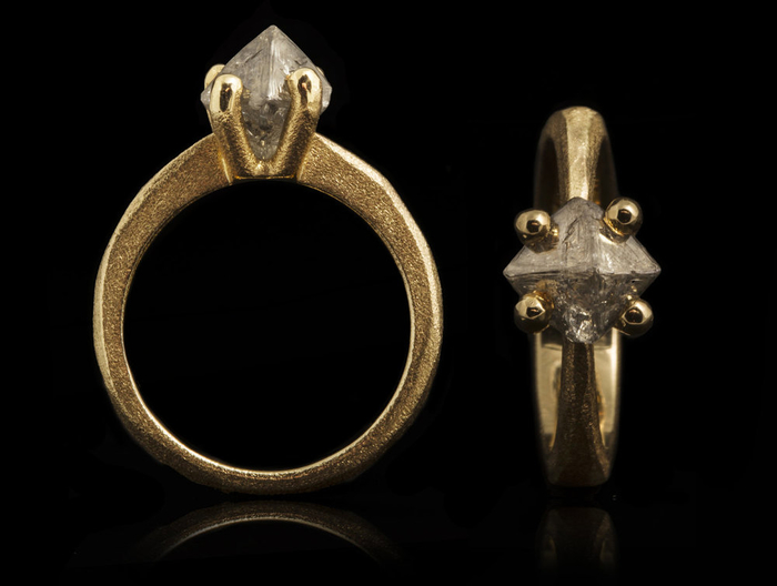 brushed-gold-metal-ring-with-an uncut diamond.jpg