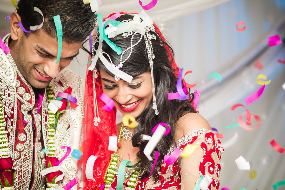 edding rbadal photography tongaat indian bride and groom confetti